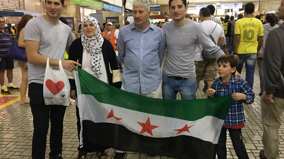 Syrian refugee family turn out to support the refugee team.